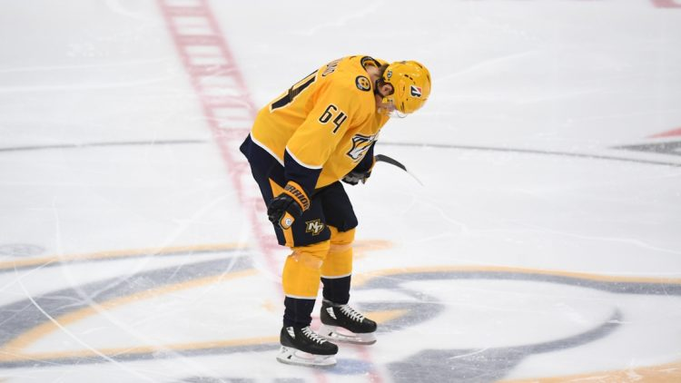 May 27, 2021; Nashville, Tennessee, USA; Nashville Predators center Mikael Granlund (64) reacts after an overtime loss against the Carolina Hurricanes in game six of the first round of the 2021 Stanley Cup Playoffs at Bridgestone Arena. Mandatory Credit: Christopher Hanewinckel-USA TODAY Sports