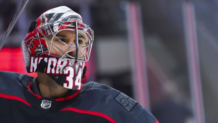 Jun 1, 2021; Raleigh, North Carolina, USA; Carolina Hurricanes goaltender Petr Mrazek (34) looks on before the game against the Tampa Bay Lightning in game two of the second round of the 2021 Stanley Cup Playoffs at PNC Arena. Mandatory Credit: James Guillory-USA TODAY Sports