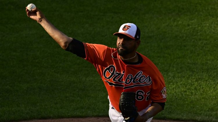 Jun 5, 2021; Baltimore, Maryland, USA;  Baltimore Orioles relief pitcher Cesar Valdez (62) delivers a seventh inning pitch Cleveland Indians at Oriole Park at Camden Yards. Mandatory Credit: Tommy Gilligan-USA TODAY Sports