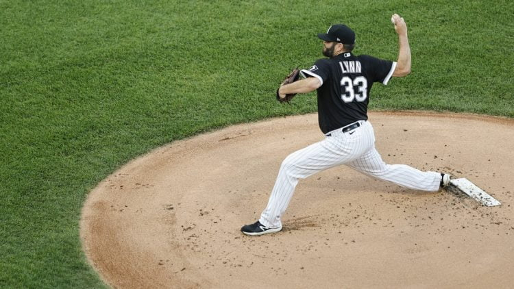 Jun 14, 2021; Chicago, Illinois, USA; Chicago White Sox starting pitcher Lance Lynn (33) delivers against the Tampa Bay Rays during the first inning at Guaranteed Rate Field. Mandatory Credit: Kamil Krzaczynski-USA TODAY Sports