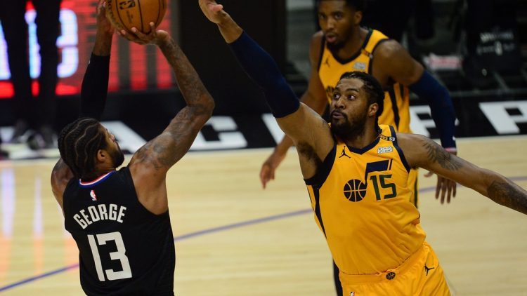 Jun 14, 2021; Los Angeles, California, USA; Los Angeles Clippers guard Paul George (13) shoots against Utah Jazz center Derrick Favors (15) during the first half in game four in the second round of the 2021 NBA Playoffs. at Staples Center. Mandatory Credit: Gary A. Vasquez-USA TODAY Sports