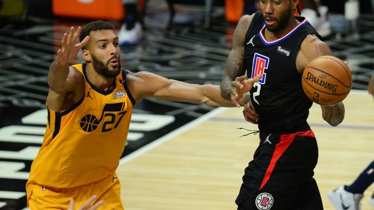 Jun 14, 2021; Los Angeles, California, USA; Los Angeles Clippers forward Kawhi Leonard (2) passes the ball against Utah Jazz center Rudy Gobert (27) during the second half in game four in the second round of the 2021 NBA Playoffs. at Staples Center. Mandatory Credit: Gary A. Vasquez-USA TODAY Sports