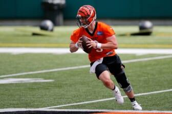Bengals quarterback Joe Burrow scrambles during a minicamp practice at Paul Brown Stadium in Cincinnati on Tuesday.  Cincinnati Bengals Mini Camp