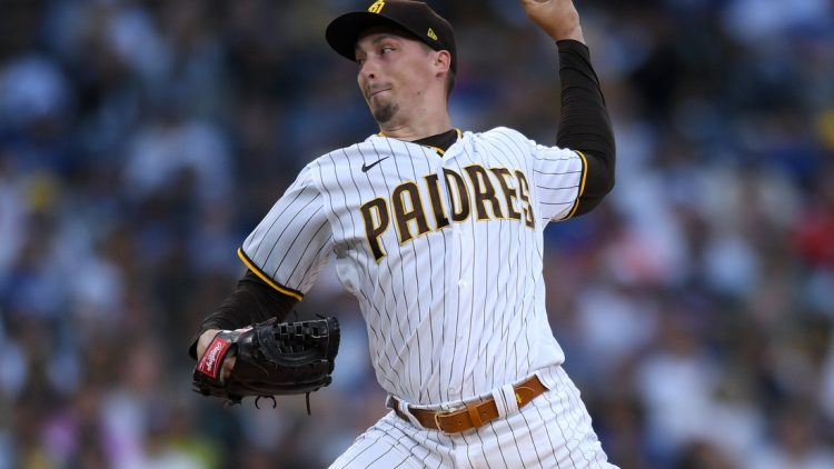 Jun 22, 2021; San Diego, California, USA; San Diego Padres starting pitcher Blake Snell (4) throws a pitch against the Los Angeles Dodgers during the first inning at Petco Park. Mandatory Credit: Orlando Ramirez-USA TODAY Sports