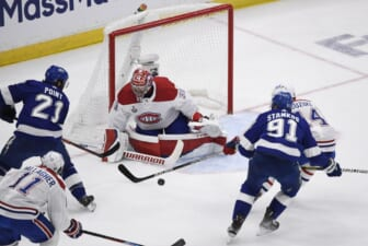 Jun 28, 2021; Tampa, Florida, USA; Montreal Canadiens goaltender Carey Price (31) makes a save between Tampa Bay Lightning center Brayden Point (21) and center Steven Stamkos (91) in the second period of game one of the 2021 Stanley Cup Final at Amalie Arena. Mandatory Credit: Douglas DeFelice-USA TODAY Sports