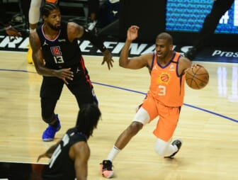 Jun 30, 2021; Los Angeles, California, USA; Phoenix Suns guard Chris Paul (3) controls the ball against Los Angeles Clippers guard Paul George (13) during the first half in game six of the Western Conference Finals for the 2021 NBA Playoffs at Staples Center. Mandatory Credit: Gary A. Vasquez-USA TODAY Sports