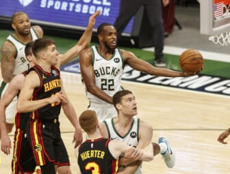 Jul 1, 2021; Milwaukee, Wisconsin, USA;  Milwaukee Bucks forward Khris Middleton (22) shoots during the second quarter against the Atlanta Hawks during game five of the Eastern Conference Finals for the 2021 NBA Playoffs at Fiserv Forum. Mandatory Credit: Jeff Hanisch-USA TODAY Sports