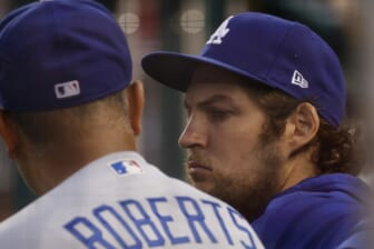 Jul 1, 2021; Washington, District of Columbia, USA; Los Angeles Dodgers starting pitcher Trevor Bauer (R) talks with Dodgers manager Dave Roberts (L) in the dugout against the Washington Nationals in the third inning at Nationals Park. Mandatory Credit: Geoff Burke-USA TODAY Sports