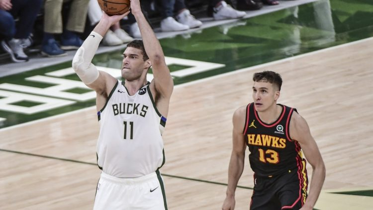 Jul 1, 2021; Milwaukee, Wisconsin, USA; Milwaukee Bucks center Brook Lopez (11) takes a shot against Atlanta Hawks guard Bogdan Bogdanovic (13) in the second quarter during game five of the Eastern Conference Finals for the 2021 NBA Playoffs at Fiserv Forum. Mandatory Credit: Benny Sieu-USA TODAY Sports