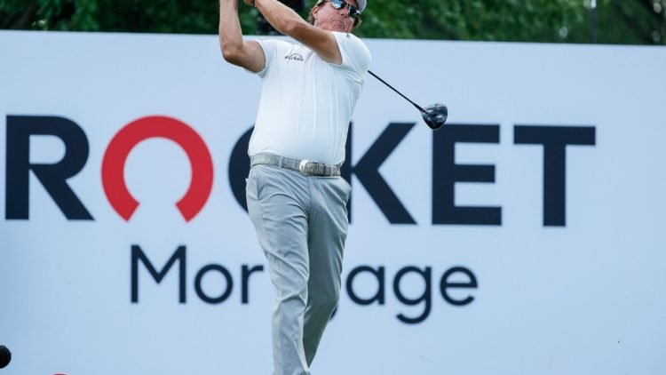 Phil Mickelson tees off on the 18th during the second round of the Rocket Mortgage Classic at the Detroit Golf Club in Detroit on Friday, July 2, 2021.