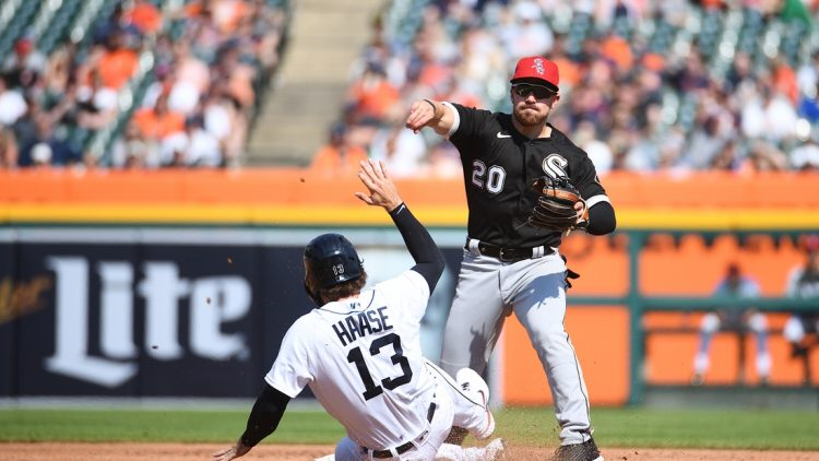 Jul 3, 2021; Detroit, Michigan, USA; Chicago White Sox second baseman Danny Mendick (20) forces Detroit Tigers left fielder Eric Haase (13) out at second base during the second inning at Comerica Park. Mandatory Credit: Tim Fuller-USA TODAY Sports