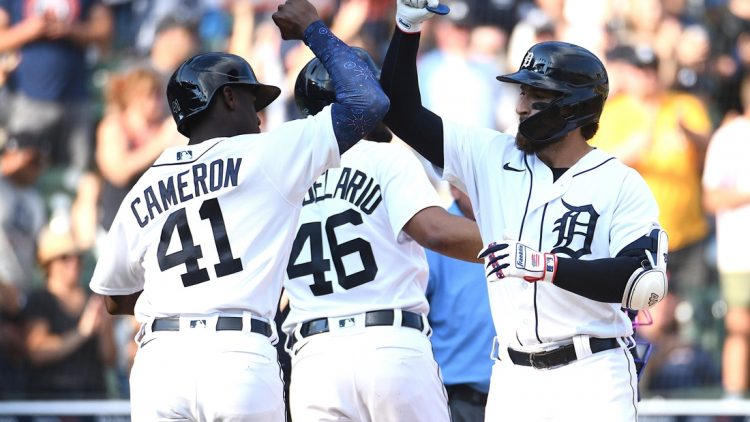 Jul 3, 2021; Detroit, Michigan, USA; Detroit Tigers left fielder Eric Haase (13) celebrates his home run with Chicago White Sox bench coach Miguel Cairo (41) during the game at Comerica Park. Mandatory Credit: Tim Fuller-USA TODAY Sports