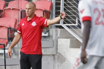 Jul 3, 2021; Washington, DC, USA; Toronto FC head coach Chris Armas gestures from the bench against D.C. United in the second half at Audi Field. Mandatory Credit: Geoff Burke-USA TODAY Sports