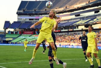 Jul 3, 2021; Nashville, TN, Nashville, TN, USA; Nashville SC defender Walker Zimmerman (25) heads the ball out of the box against the Philadelphia Union during the first half at Nissan Stadium. Mandatory Credit: Christopher Hanewinckel-USA TODAY Sports