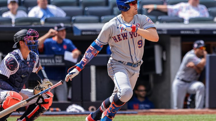 Jul 4, 2021; Bronx, New York, USA; New York Mets center fielder Brandon Nimmo (9) hits an RBI single during the fourth inning against the New York Yankees at Yankee Stadium. Mandatory Credit: Vincent Carchietta-USA TODAY Sports