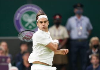Jul 5, 2021; London, United Kingdom;  Roger Federer (SUI) in action against Lorenzo Sonego (ITA) on the Centre court in the  fourth round at All England Lawn Tennis and Croquet Club. Mandatory Credit: Peter van den Berg-USA TODAY Sports