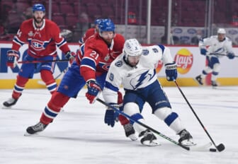 Jul 5, 2021; Montreal, Quebec, CAN; Tampa Bay Lightning center Tyler Johnson (9) controls the puck as Montreal Canadiens center Eric Staal (21) defends during the first period in game four of the 2021 Stanley Cup Final at the Bell Centre. Mandatory Credit: Eric Bolte-USA TODAY Sports