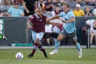 Jul 7, 2021; Commerce City, Colorado, USA; Colorado Rapids forward Michael Barrios (12) and Minnesota United FC defender Chase Gasper (77) battle for the ball in the first half at Dick's Sporting Goods Park. Mandatory Credit: Isaiah J. Downing-USA TODAY Sports
