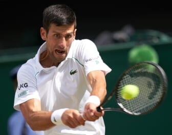 Jul 11, 2021; London, United Kingdom; Novak Djokovic (SRB) hits the ball against Matteo Berrettini (ITA) in the men s final  on Centre Court at All England Lawn Tennis and Croquet Club. Mandatory Credit: Peter van den Berg-USA TODAY Sports