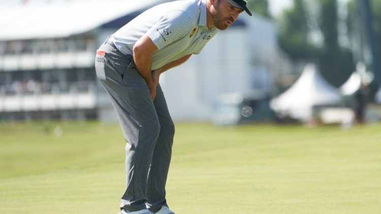 Jul 17, 2021; Sandwich, England, GBR; Louis Oosthuizen reacts to his putt on the first green during the third round of the Open Championship golf tournament. Mandatory Credit: Peter van den Berg-USA TODAY Sports