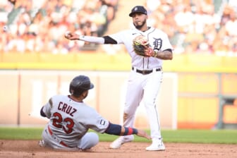 Jul 17, 2021; Detroit, Michigan, USA; Detroit Tigers second baseman Harold Castro (right) forces Minnesota Twins designated hitter Nelson Cruz (23) out at second base and throws to first base during the fifth inning at Comerica Park. Mandatory Credit: Tim Fuller-USA TODAY Sports