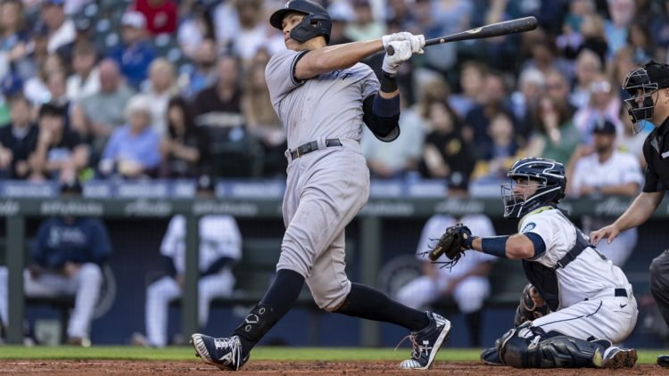 Jul 7, 2021; Seattle, Washington, USA; New York Yankees outfielder Aaron Judge (99) hits a home run during a game against the Seattle Mariners at T-Mobile Park. The Yankees won 5-4. Mandatory Credit: Stephen Brashear-USA TODAY Sports
