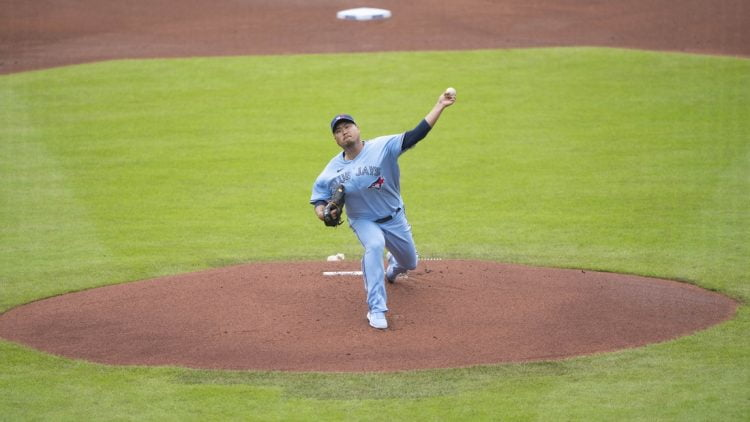 Jul 18, 2021; Buffalo, New York, CAN; Toronto Blue Jays pitcher Hyun Jin Ryu (99) delivers a pitch during the first inning against the Texas Rangers at Sahlen Field. Mandatory Credit: Gregory Fisher-USA TODAY Sports