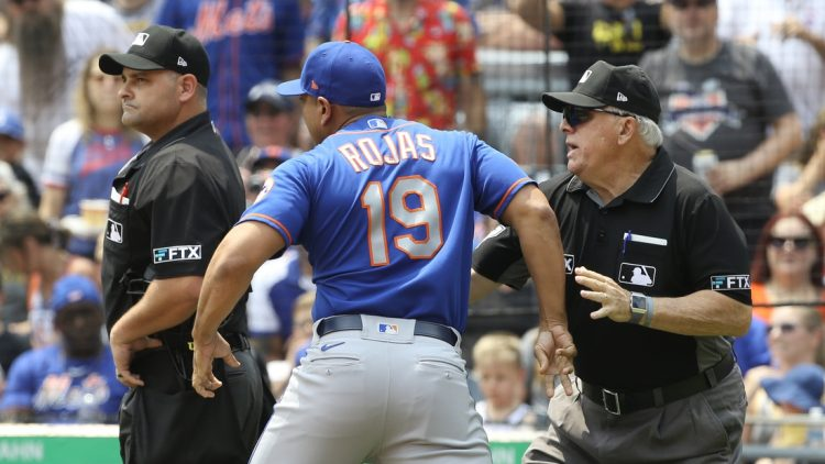 Jul 18, 2021; Pittsburgh, Pennsylvania, USA;  MLB crew chief umpire Larry Vanover (right) restrains New York Mets manager Luis Rojas (19) after a call by home plate umpire Jeremy Riggs (112) ejecting Rojas from the game against the Pittsburgh Pirates during the first inning at PNC Park. Mandatory Credit: Charles LeClaire-USA TODAY Sports