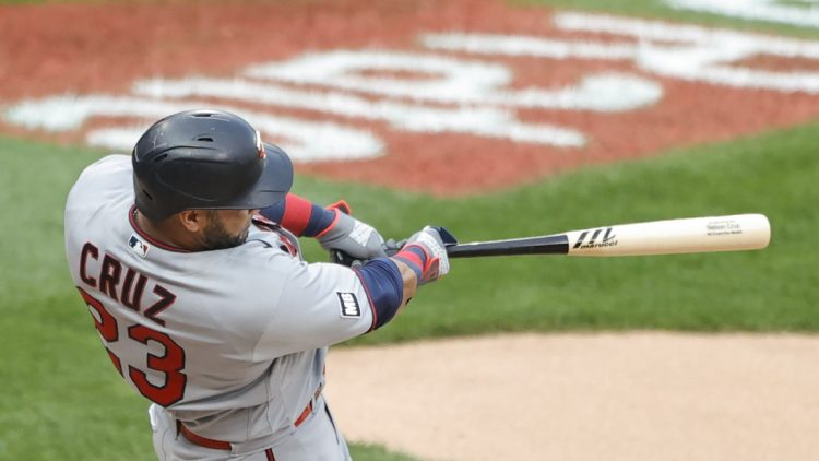 Jul 19, 2021; Chicago, Illinois, USA; Minnesota Twins designated hitter Nelson Cruz (23) hits a solo home run against the Chicago White Sox during the sixth inning of a Game 1 of the doubleheader at Guaranteed Rate Field. Mandatory Credit: Kamil Krzaczynski-USA TODAY Sports