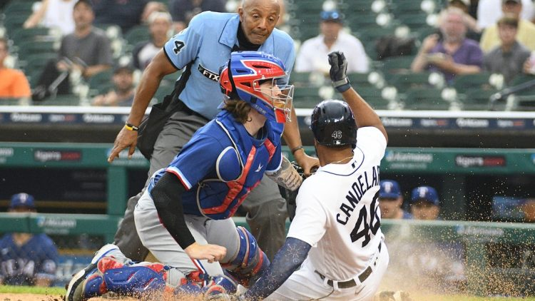 Jul 19, 2021; Detroit, Michigan, USA; Texas Rangers catcher Jonah Heim (28) tags out Detroit Tigers designated hitter Jeimer Candelario (46) at home during the fourth inning at Comerica Park. Mandatory Credit: Tim Fuller-USA TODAY Sports