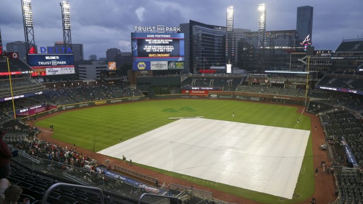 Jul 19, 2021; Atlanta, Georgia, USA; General view of the tarp on the field at Truist Park after a game was canceled between the Atlanta Braves and San Diego Padres due to rain. Mandatory Credit: Brett Davis-USA TODAY Sports