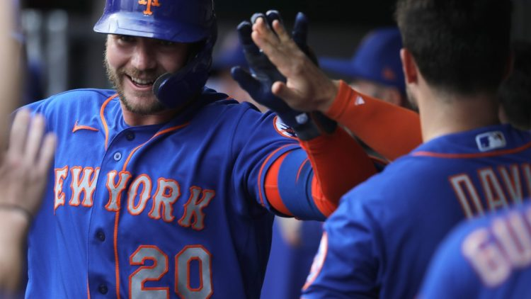 Jul 19, 2021; Cincinnati, Ohio, USA; New York Mets first baseman Pete Alonso (20) celebrates in the dugout after hitting a two-run home run against the Cincinnati Reds during the first inning at Great American Ball Park. Mandatory Credit: David Kohl-USA TODAY Sports