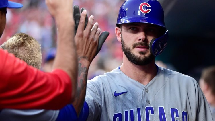 Jul 20, 2021; St. Louis, Missouri, USA;  Chicago Cubs left fielder Kris Bryant (17) is congratulated by teammates after scoring during the second inning against the St. Louis Cardinals at Busch Stadium. Mandatory Credit: Jeff Curry-USA TODAY Sports