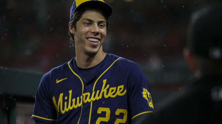 Jul 17, 2021; Cincinnati, Ohio, USA; Milwaukee Brewers left fielder Christian Yelich (22) during the rain delay in the seventh inning of the game against the Cincinnati Reds at Great American Ball Park. Mandatory Credit: Katie Stratman-USA TODAY Sports