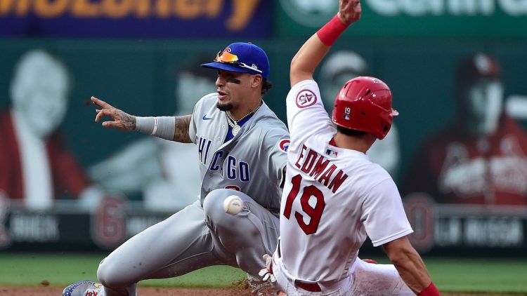 Jul 22, 2021; St. Louis, Missouri, USA;  Chicago Cubs shortstop Javier Baez (9) catches the throw and tags out St. Louis Cardinals second baseman Tommy Edman (19) as he attempts to steal second during the second inning at Busch Stadium. Mandatory Credit: Jeff Curry-USA TODAY Sports
