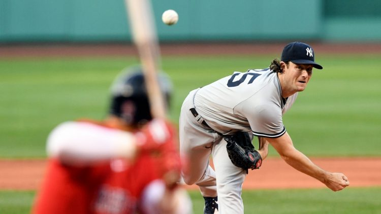 Jul 23, 2021; Boston, Massachusetts, USA; New York Yankees starting pitcher Gerrit Cole (45) pitches against the Boston Red Sox during the first inning at Fenway Park. Mandatory Credit: Brian Fluharty-USA TODAY Sports