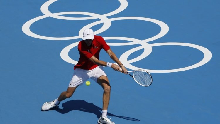 Jul 24, 2021; Tokyo, Japan; Daniil Medvedev of the Russian Olympic Committee hits a backhand against Alexander Bublik of Kazakhstan (not pictured) in a first round men's singles match during the Tokyo 2020 Olympic Summer Games at Ariake Tennis Park. Mandatory Credit: Geoff Burke-USA TODAY Network