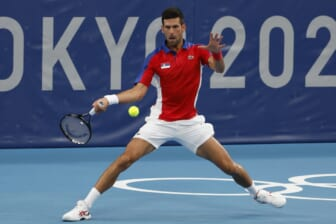 Jul 26, 2021; Tokyo, Japan; Novak Djokovic of Serbia hits a forehand against Jan-Lennard Struff of Germany (not pictured) in a second round mens' singles match during the Tokyo 2020 Olympic Summer Games at Ariake Tennis Park. Mandatory Credit: Geoff Burke-USA TODAY Sports