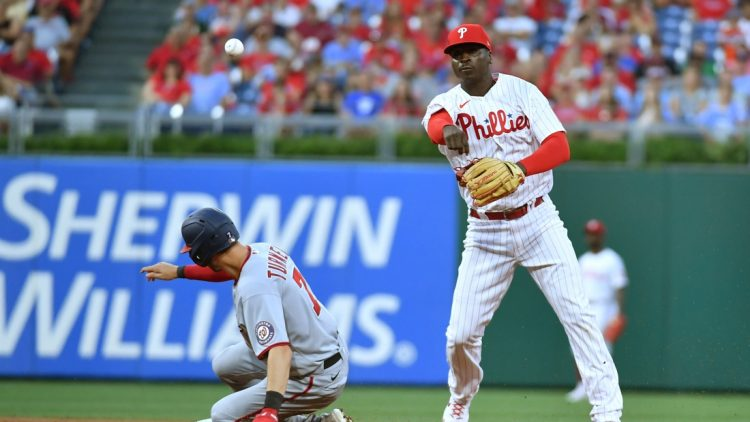 Jul 26, 2021; Philadelphia, Pennsylvania, USA; Philadelphia Phillies shortstop Didi Gregorius (18) throws to first base to complete a double play over Washington Nationals shortstop Trea Turner (7) during the fourth inning at Citizens Bank Park. Mandatory Credit: Eric Hartline-USA TODAY Sports