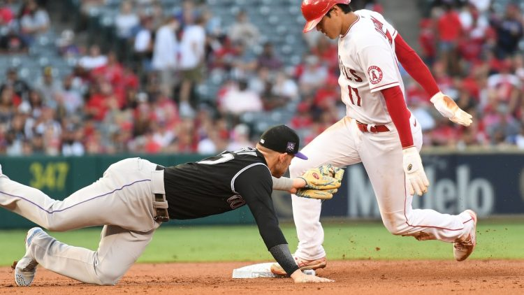 Jul 26, 2021; Anaheim, California, USA; Los Angeles Angels starting pitcher Shohei Ohtani (17) steals second against Colorado Rockies shortstop Trevor Story (27) during the first inning at Angel Stadium. Mandatory Credit: Richard Mackson-USA TODAY Sports