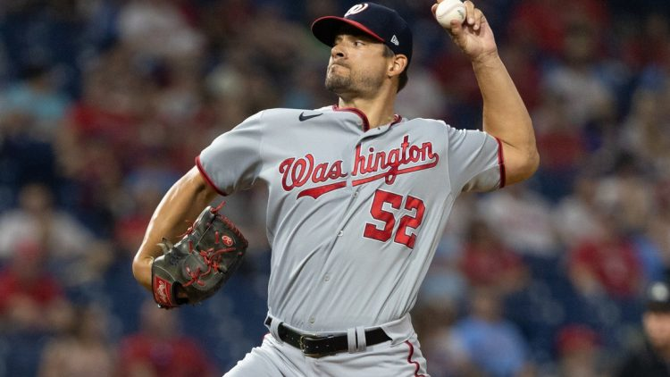 Jul 27, 2021; Philadelphia, Pennsylvania, USA; Washington Nationals relief pitcher Brad Hand (52) throws against the Philadelphia Phillies during the ninth inning at Citizens Bank Park. Mandatory Credit: Bill Streicher-USA TODAY Sports
