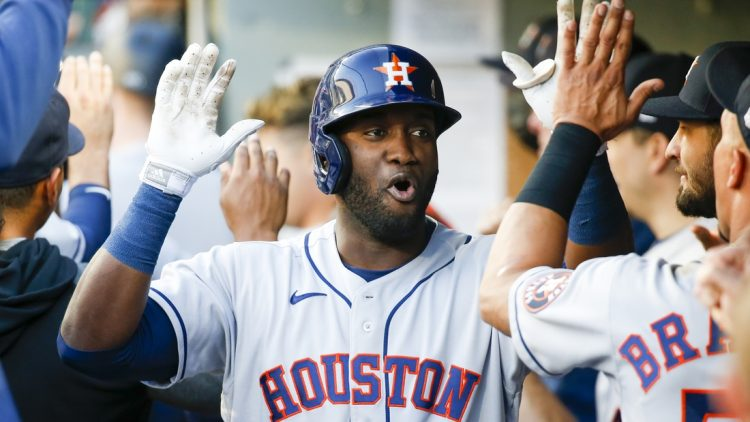 Jul 27, 2021; Seattle, Washington, USA; Houston Astros left fielder Yordan Alvarez (44) exchanges high fives in the dugout after hitting a three-run home run against the Seattle Mariners during the first inning at T-Mobile Park. Mandatory Credit: Joe Nicholson-USA TODAY Sports