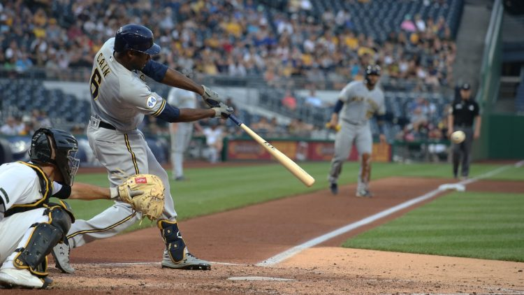 Jul 28, 2021; Pittsburgh, Pennsylvania, USA; Milwaukee Brewers center fielder Lorenzo Cain (6) hits a two run single against the Pittsburgh Pirates during the fourth inning at PNC Park. Mandatory Credit: Charles LeClaire-USA TODAY Sports
