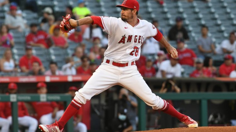 Jul 28, 2021; Anaheim, California, USA; Los Angeles Angels starting pitcher Andrew Heaney (28) throws against the Colorado Rockies during the first inning at Angel Stadium. Mandatory Credit: Richard Mackson-USA TODAY Sports