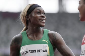 Jul 30, 2021; Tokyo, Japan; Elaine Thompson-Herah (JAM) after competing in the women's 100m preliminary round 1, heat 2during the Tokyo 2020 Olympic Summer Games at Olympic Stadium. Mandatory Credit: James Lang-USA TODAY Sports