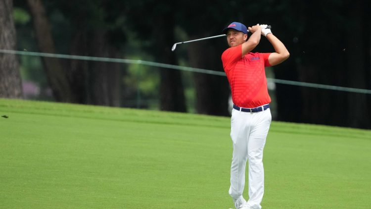 Jul 30, 2021; Tokyo, Japan; Xander Schauffele (USA) hits on the third hole during round two of the men's individual stroke play of the Tokyo 2020 Olympic Summer Games at Kasumigaseki Country Club. Mandatory Credit: Kyle Terada-USA TODAY Sports