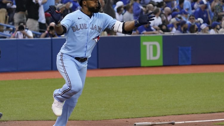Jul 30, 2021; Toronto, Ontario, CAN; Toronto Blue Jays left fielder Teoscar Hernandez (37) reacts after hitting a solo homerun against the Kansas City Royals during the second inning at Rogers Centre. Mandatory Credit: John E. Sokolowski-USA TODAY Sports