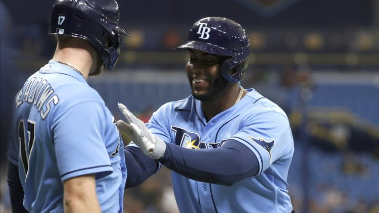 Jul 30, 2021; St. Petersburg, Florida, USA; Tampa Bay Rays first baseman Yandy Diaz (2) is congratulated by Tampa Bay Rays left fielder Austin Meadows (17) after he hit a two run home run during the first inning against the Boston Red Sox at Tropicana Field. Mandatory Credit: Kim Klement-USA TODAY Sports