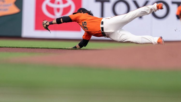 Jul 30, 2021; San Francisco, California, USA;  San Francisco Giants shortstop Brandon Crawford (35) dives but cannot catch the baseball during the first inning against the Houston Astros at Oracle Park. Mandatory Credit: Neville E. Guard-USA TODAY Sports