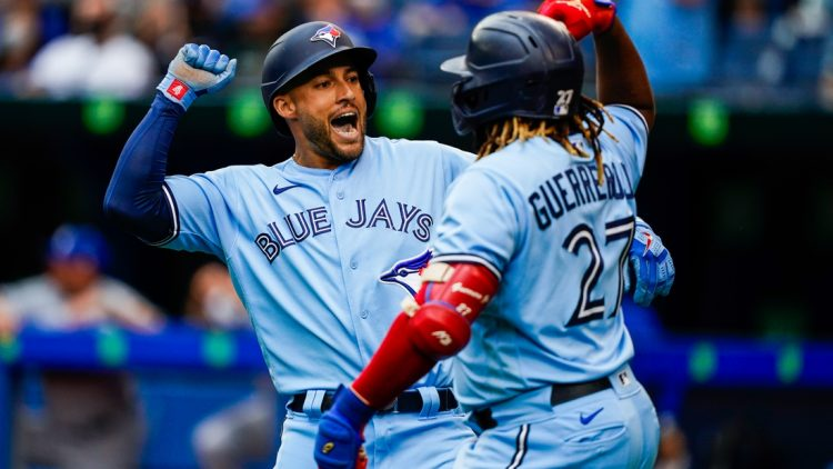Jul 31, 2021; Toronto, Ontario, CAN; Toronto Blue Jays center fielder George Springer (4) celebrates with designated hitter Vladimir Guerrero Jr. (27) after hitting a home run against the Kansas City Royals during the first inning at Rogers Centre. Mandatory Credit: Kevin Sousa-USA TODAY Sports
